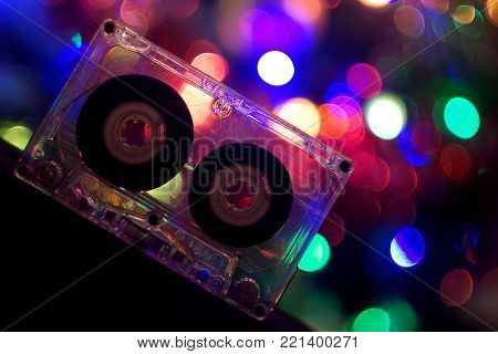 Audio tapes for tape recorder 70s 80s 90s bokeh vintage fashion old retro wallpaper background closeup nostalgia music sound style