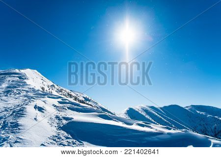 Snowy ridge of mountains, Winter mountains background, Background european alps, Winter landscape with sun, European snowy landscape