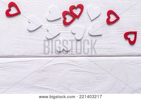 Happy Valentine's day. Valentine's day background. Red and white hearts on a white wooden background. Free space