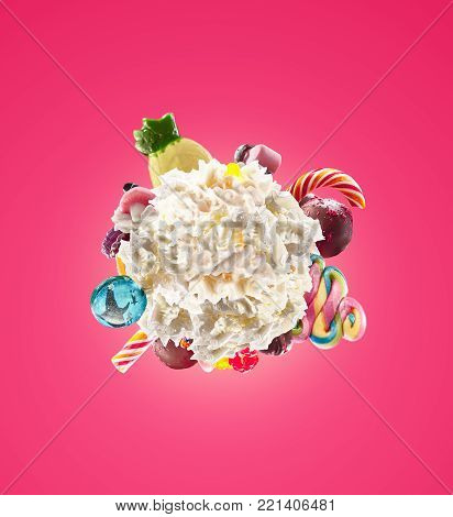 Whipped round cream with colored sweets, jelly and candies isolated. Sweet life concept. Sweet dessert - whipped milk cream concept with treat, kid cartoon colorful cream, white whipped cream with colored sweets isolated