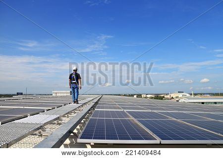 Solar PV Rooftop with Technician Walking on the Grating Walkway poster