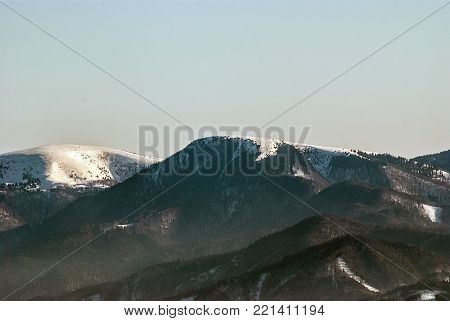 Borisov and Ploska hills in Velka Fatra mountains from Mincol hill in Mala Fatra mountains in Slovakia during winter day with clear sky