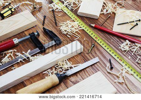 working tool carpenter ruler, chisel, pencil, sawdust and shavings poster