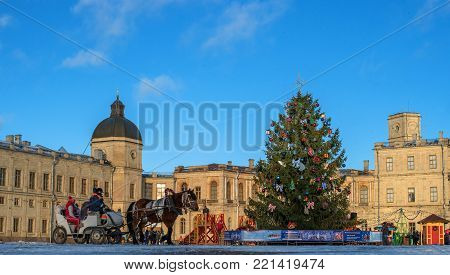 Gatchina, Russia - January 7, 2018: Gatchina Palace, New Year's Fair on the parade ground. Panorama on the background of the palace with a Christmas tree, fair.