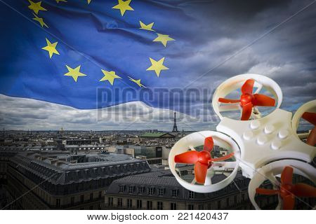 Mini drone flying over Paris cityscape. The EU is working on a regulation to safely integrate piloted drones into the European airspace.The regulation is expected to be completed in spring 2018