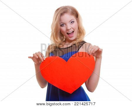 Red heart card. Love symbol. Portrait beautiful woman hold Valentine day symbol. Cute crazy blonde girl in blue dress expressing tender feelings. Isolated studio shot