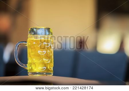 Glass mug of golden light beer in bar or in pub close up. Real scene. Concept of beer culture, Craft brewery, uniqueness of beer grades, meeting of low alcohol beverage lovers. Copy space