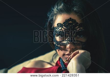 woman with venetian mask. Secret. Fashion. Venetian carnival.