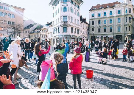 LJUBLJANA, SLOVENIA - FEBRUARY 6: People celebrate - pust - in Slovenian means Shrovetide Carnival - at old center on February 6, 2016 in Ljubljana, Slovenia.