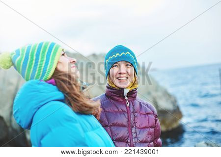 funny laughing girlfriend near the sea in winter
