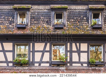 Detail of a half-timbered facade of a traditional Alsatian house.