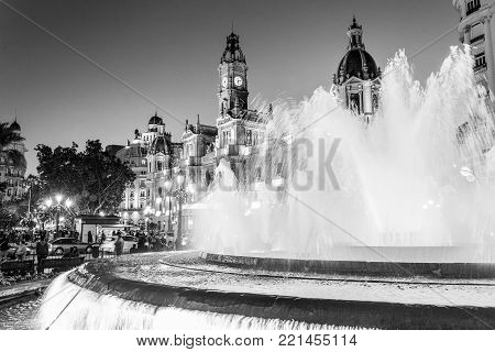 Fountain on Modernism Plaza of the City Hall of Valencia, Town hall Square, Spain. Modernisme Plaza of the City Hall of Valencia Placa del Ajuntament. Black and white horizontal image.