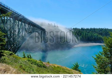 Scenic view of  Deception Pass Bridge in fog.  Anacortes. Whidbey Island. Strait of Juan de Fuca. Puget Sound.  WA. USA.