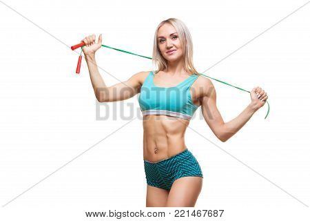 Sport, activity. Cute woman with skipping rope. Muscular woman white background