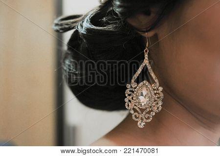A Bid White Earring In The Ear Of Woman