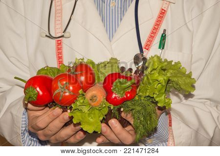 Fresh vegetables, measuring tape with diet plan. Healthy food marketing. Products with low fat content. Close-up of male nutritionist hands measuring vegetables with tape. Healthy, Diet concept