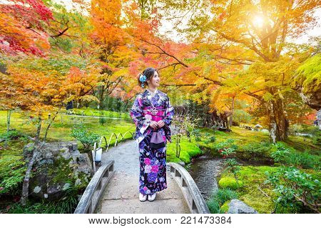 Asian Woman Wearing Japanese Traditional Kimono In Autumn Park. Japan