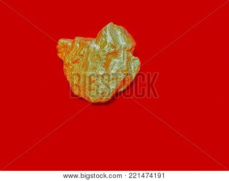 macro Gold ore in the boulder , precious stone Gold gemstones are mined from gold mines, luxury on red background