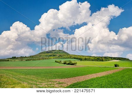 national mystic hill Rip, Central Bohemia, Czech republic - spring landscape with green fields and blue sky with clouds