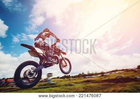 debris in a motocross race jump blue sky