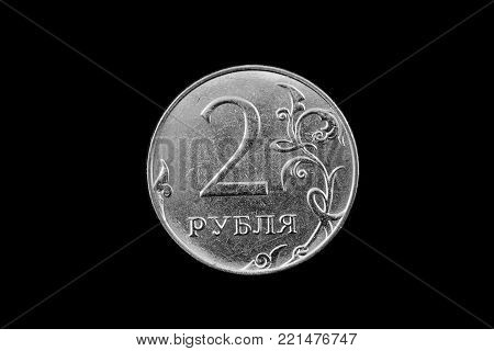 A super macro image of a silver Russian two kopeck coin isolated on a black background