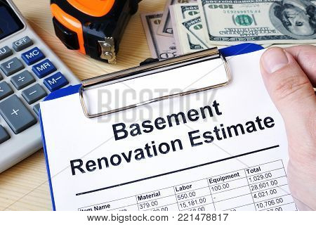Clipboard with calculations basement renovation estimate. Remodel budget.