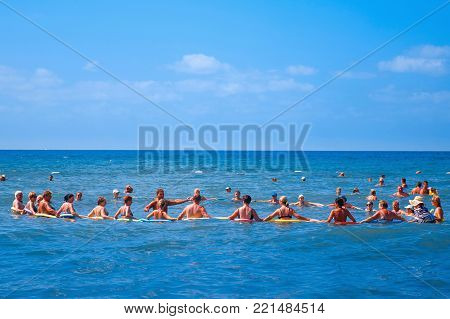 Antalya, Turkey - September 26, 2017: group of people in the sea is engaged with an aqua aerobics trainer