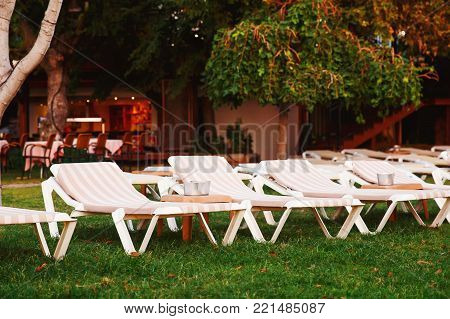 Sun lounger beds on the hotel. Concept place for recreation.