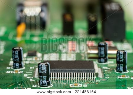 Close up of printed electronic circuit board with microcontroller and components;