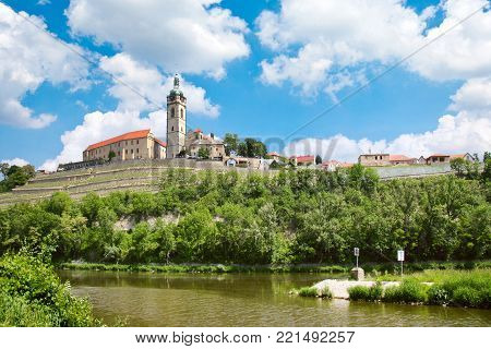 CZECH REPUBLIC, MELNIK - APR 27, 2016: Renaissance Chateau and Church of Sts. Peter and Paul, Labe river, Melnik, Czech Republic