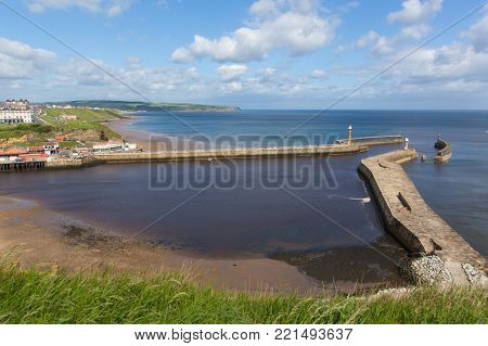 Whitby harbour entrance and coast North Yorkshire England uk