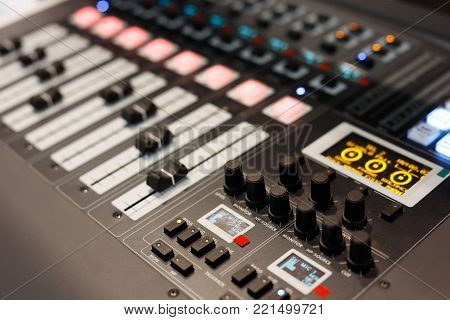 Close up view of multichannel digital audio mixing console. Selective focus.