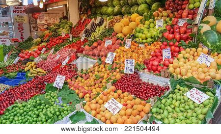 Istanbul, Turkey - June 02, 2017: Fruits and vegetables on display in grocery in Kadikoy street bazaar. Kadikoy is the most ancient district of Istanbul, located in the Asian part of the city.