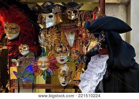 Traditional venetian masks and a medieval doctor costume. Venetian carnival is an annual costume festival, which attracts many tourists.