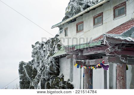 KACHKANAR, RUSSIA - JANUARY 09, 2018: a fragment of the building attached to the rock in the Buddhist monastery of Shad Tchup Ling in the Urals.