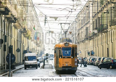 TURIN, ITALY - JANUARY 2011: Tram train for public transport in Via Po, historical center of the city of Turin. Tram is one of Turin's characteristic public transportation