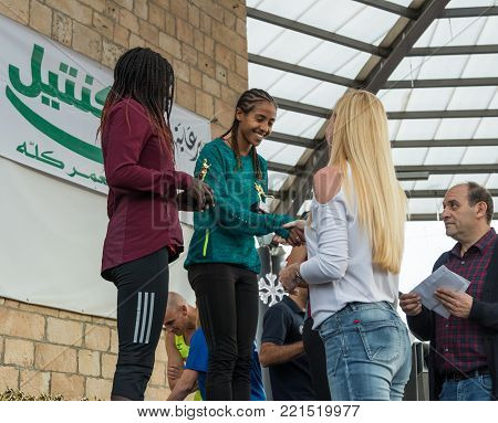 Mi'ilya, Israel, December 22, 2017 : Presentation of memorable cups to the winners of the annual race