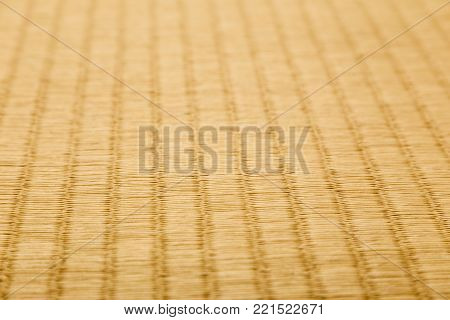 close up of tatami, japanese traditional room floor matt, showing craftmanship and design, low angle with shallow depth of field, good for using as background in hand craft or nature theme