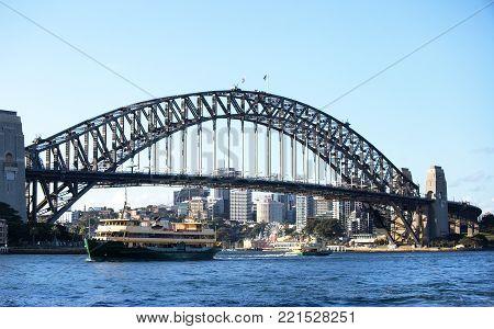 SYDNEY, AUSTRALIA - NOV 8, 2017: A ferry crosses Sydney Harbour in front of the Harbour Bridge