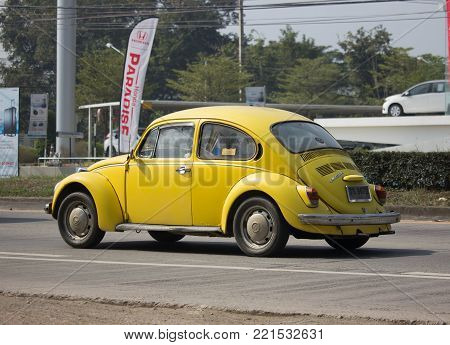 CHIANG MAI, THAILAND -JANUARY 7 2018:  Vintage Private Car, Yellow of Volkswagen beetle. Photo at road no.1001 about 8 km from downtown Chiangmai, thailand.