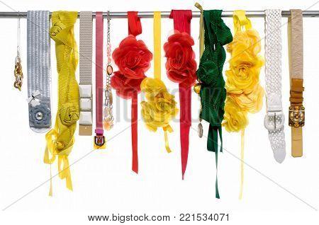 Set of woman many colorful belts ,scarf, flower belts on hanger