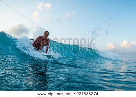 Woman surfer starts ride the wave