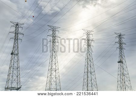 power lines and pylons against cloud sky near Kentucky Dam and power plant