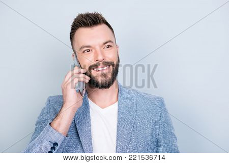 Cheerful Brunet Bearded Businessman Is Smiling, Talking To Business Partner About Success Of The Com