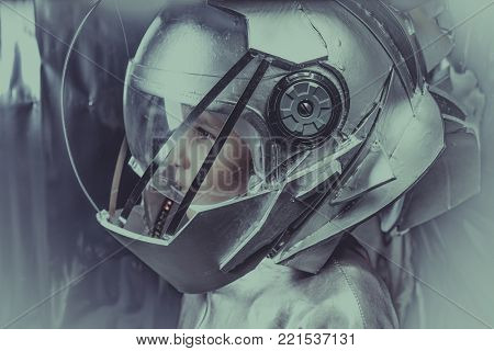 Cosmonaut, Boy playing to be an astronaut with space helmet and metal suit over silver background