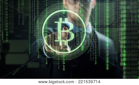cryptocurrency, finance and business concept - close up of businessman with virtual bitcoin symbol hologram over and binary code and black background