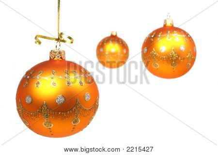 Three New Year's Spheres Of Yellow Color On White