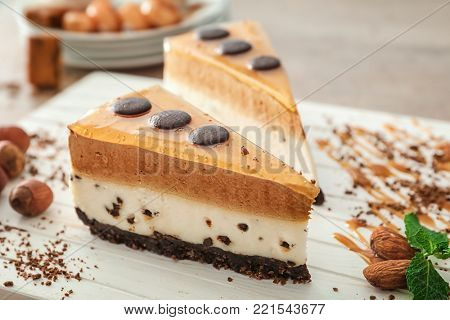 Yummy dessert with caramel and chocolate on wooden board