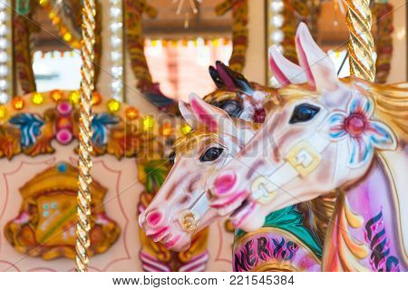 Horses on a fun fair merry go round carousel