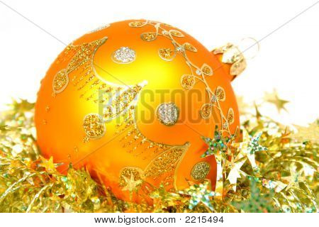 Celebratory Sphere Of Yellow Color And Golden Tinsel
